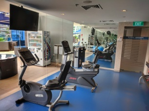 Four Points by Sheraton, hotel in Singapore off Robertson Quay. Seen here is the view of the gym, 3 treadmills, bike, yoga mats, gym by the pool.
