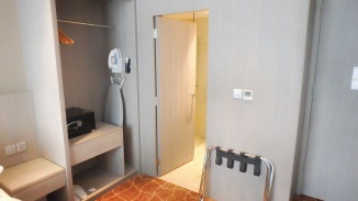 Four Points by Sheraton, hotel in Singapore off Robertson Quay. Seen here is the room facing the bathroom, with its ironing facilities, in-room safe, wardrobe and bedside table.