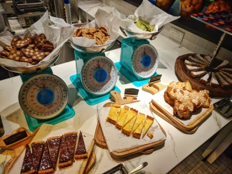 Beach Road Kitchen at JW Marriot off Singapre's CBD. Dinner buffet served here with spread of seafood and delicacies. Seen here is the pastries counter decked with chocolate tarts, lemon tarts, bread and cookies decorated with nostalgic, old school weighing scales