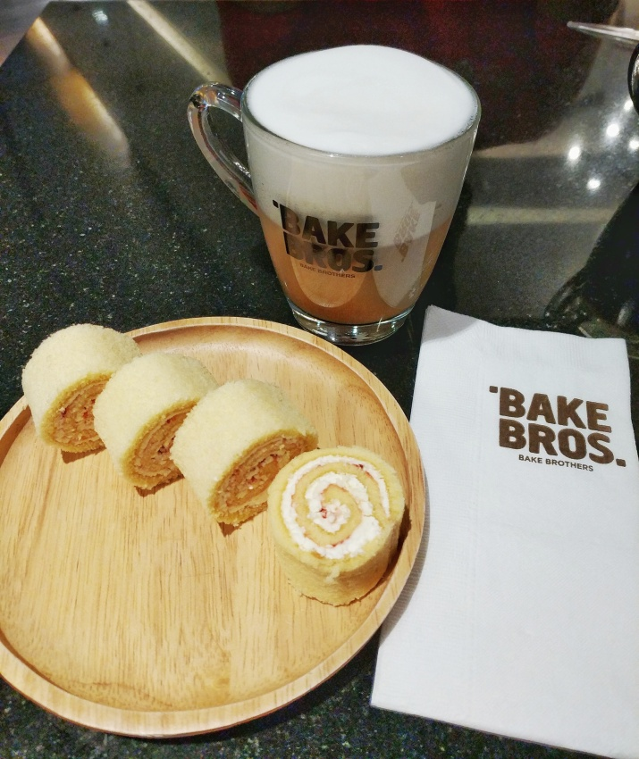 Bake Brothers cafe in Terminal 21 Bangkok, seen with mango swiss roll and cappuccino