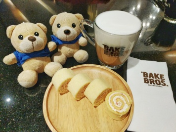 Xiong Xiong the teddy bears at the Bake Brothers cafe in Terminal 21 Bangkok, seen with mango swiss roll and cappuccino