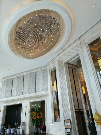 Terminal 21 Hotel Grande Centre Point lobby at Bangkok Thailand, chandelier at the top