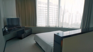 Terminal 21 Hotel Grande Centre Point room with queen size bed, TV, plenty of space, full length window with bangkok city view