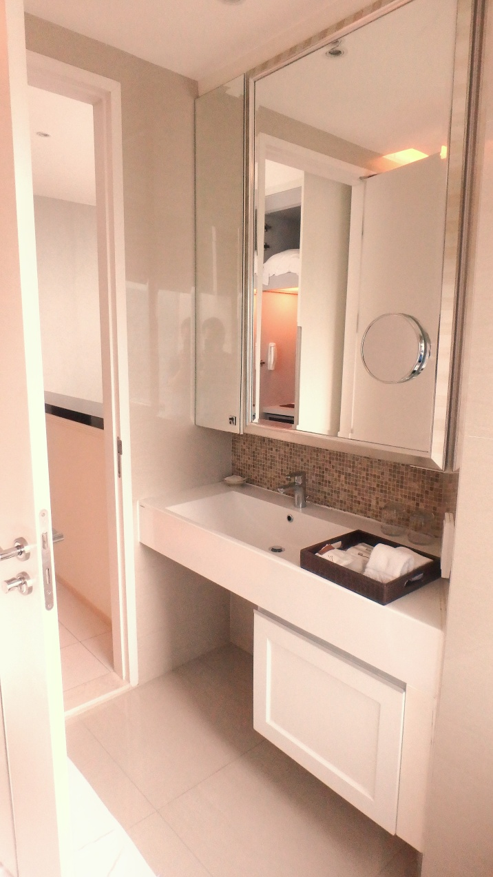 Terminal 21 Hotel Grande Centre Point toilet with spacious vanity counter, big mirror and clean interiors